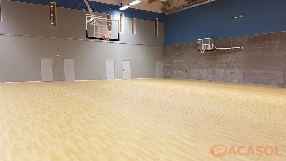 Pose d'un revêtement de sol sportif Taraflex Sport M Performance Confort dans le gymnase du Collège Jean Giono à Marseille - Pacasol
